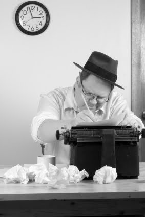 frustrated-writer-at-typewriter-photo